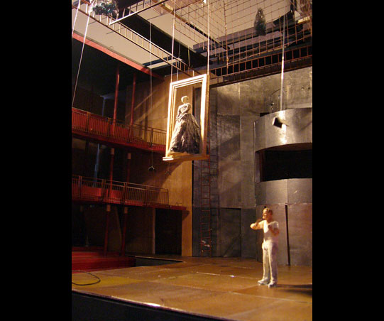 A model of a woman is lowered from the ceiling in a wooden frame
