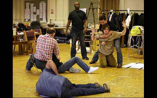 Actors practising fights by feigning injury or working in pairs on their moves