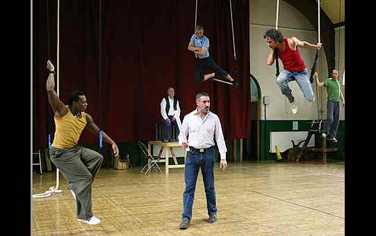In rehearsals, with men suspended from trapezes