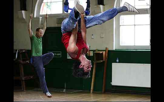 Anthony Bunsee and John Mackay rehearse on the trapezes