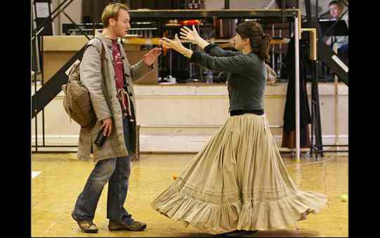 Maureen Beatty rehearses saying goodbye to Nym, stretching her arms towards him