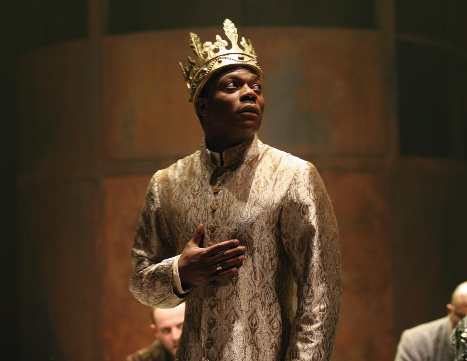 Chuk Iwuji as Henry VI, wearing a slick golden robe and a crown