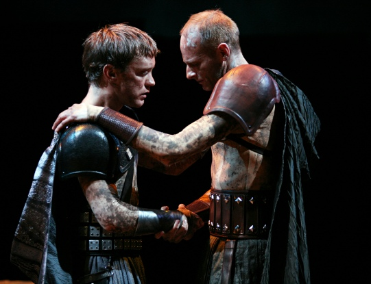Two men in Roman armour shake hands
