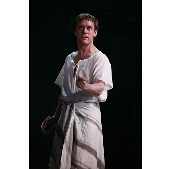 A man stands in a white robe