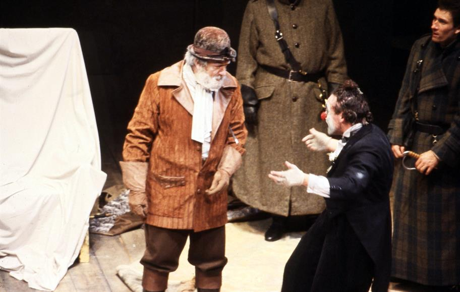 Lear (Michael Gambon) wearing hunting clothes welcomes his red-nosed Fool (Antony Sher) in King Lear, 1982