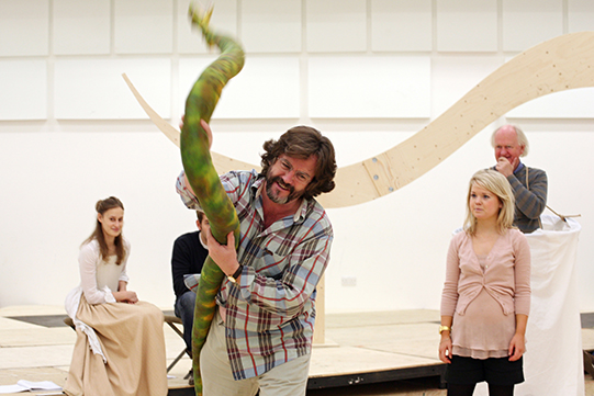 Gregory Doran holding snake in rehearsals for Love's Labour's Lost 2008
