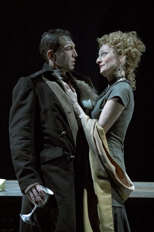 Greg Hicks as Macbeth in a heavy winter coat, Sian Thomas as Lady Macbeth in a grey long dress