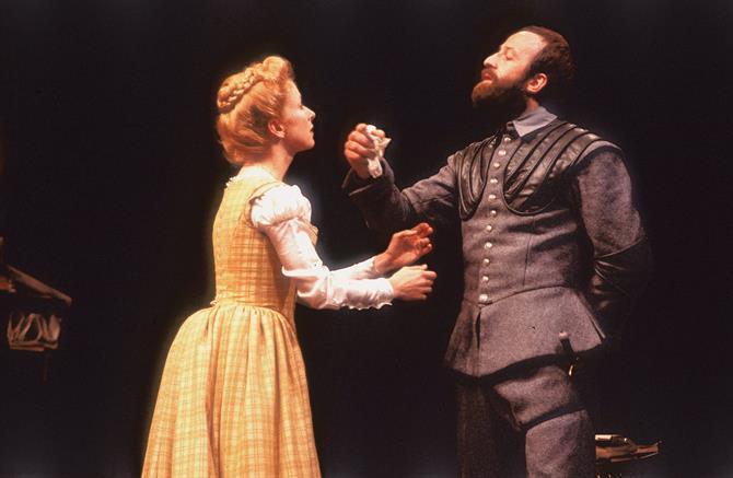 Emilia (Susan Tracy) hands over the handkerchief to Iago (Bob Peck) in Othello 1979
