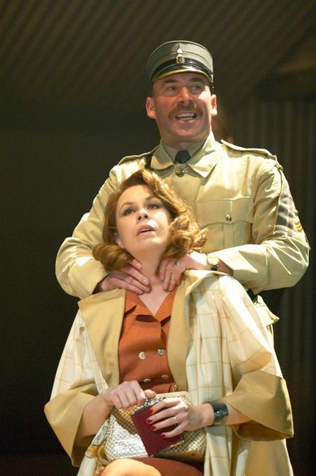 Iago (Antony Sher) places his hands around Emilia's (Amanda Harris) throat in Othello 2004