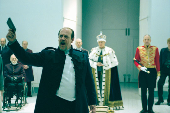 David Troughton ( Bolingbroke) surrounded by the minimalist white set and modern costume design in 2000 Richard II