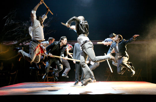 The fighting between the Capulets and Montagues is performed as a dance with long sticks.