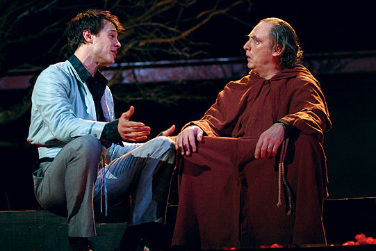 Romeo (Rupert Evans) talks to Friar Laurence (David Fielder).