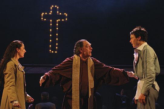 Friar Laurence (David Fielder) marries Romeo (Rupert Evans) and Juliet (Morven Christie).