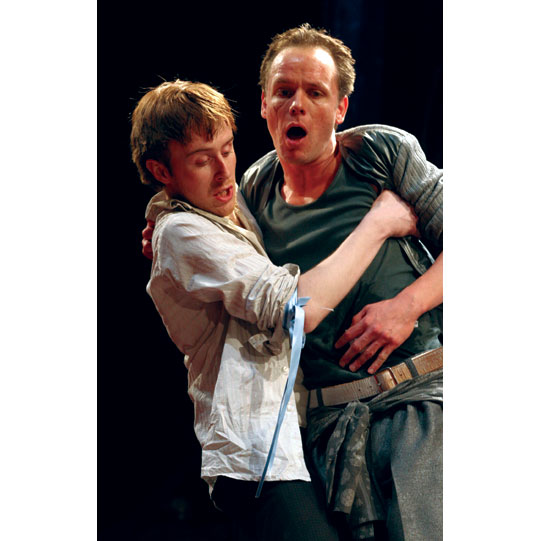 Mercutio (Jamie Ballard), fatally injured, is supported by Balthasar (John Heffernan).