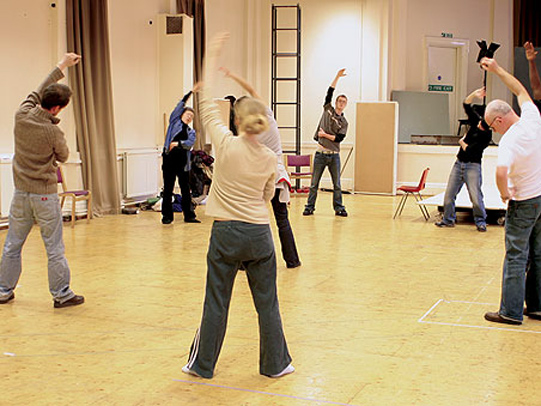 The cast rehearsing in a voice workshop.