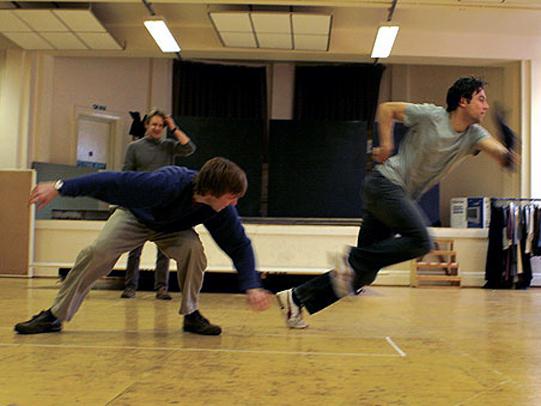 A cast improvisation workshop during rehearsal.