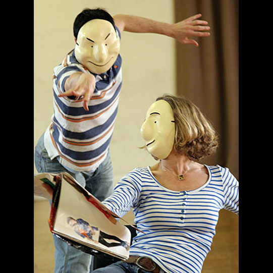 The cast in a body language workshop using masks during rehearsal.