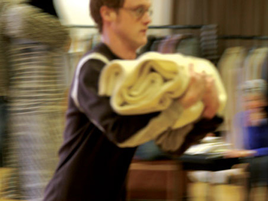 Chris Davies rehearsing a servant scene rushing with a cloth.