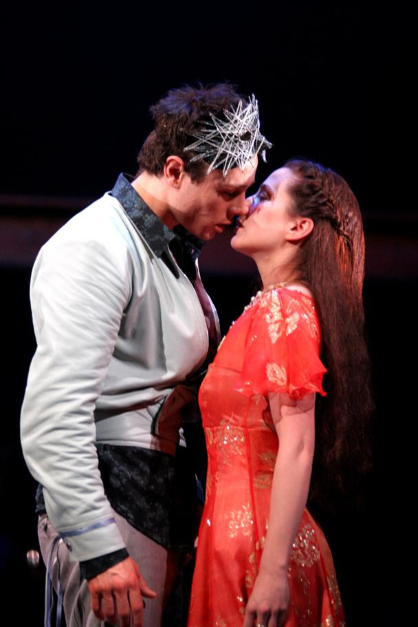 Romeo and Juliet lean in for a kiss at the masked ball