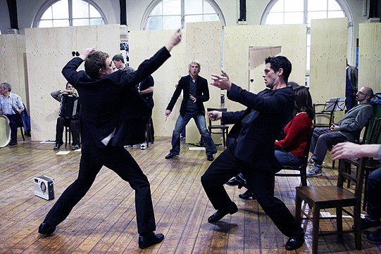 Mark Holgate (Tybalt) and Daniel Percival (Benvolio) rehearse a fight with knives. There is a radio on the floor that was used in the production.
