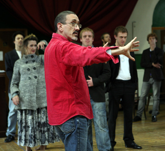 Director Neil Bartlett explains something to the cast during rehearsals