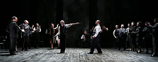 Lord Capulet (Christopher Hunter) brandishes his knife at Lord Montague (Mark Ross).