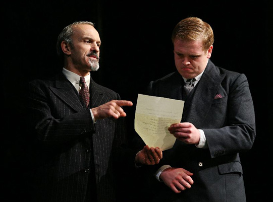 Lord Capulet (Christopher Hunter) gives Peter (Owain Arthur) a list of the guests for the ball. But Peter can't read...