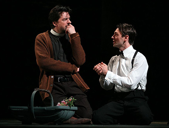 Romeo (David Dawson) urges Friar Lawrence (James Clyde) to marry him to Juliet.