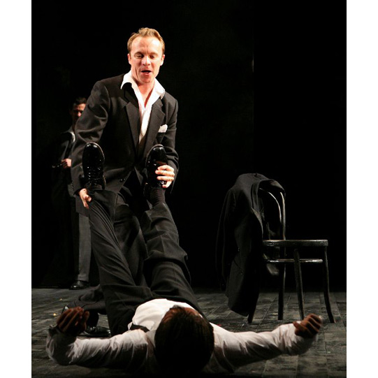 Mercutio (Gyuri Sarossy) and Romeo (David Dawson) joke and mock-fight.