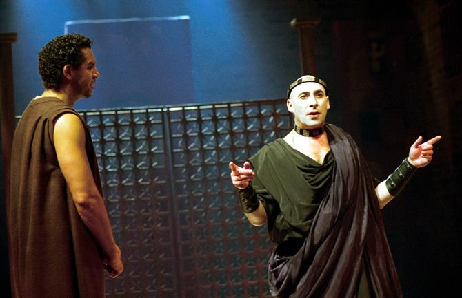 A picture from The Roman Actor which shows Paris the tragedian on the left and Domitian Caesar on the right, wearing a green toga, gauntlets and a  crown