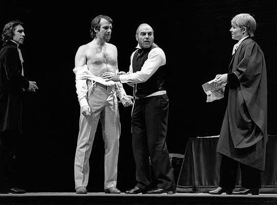 Antonio stands exposed, ready for Shylock to take his pound of flesh.