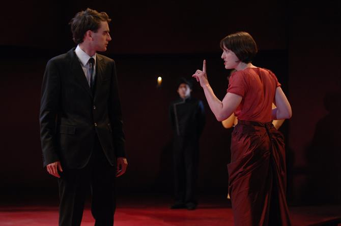 Portia (Georgina Rich) raising her finger to Bassanio (Jack Laskey) telling him his heart is as empty as her finger.