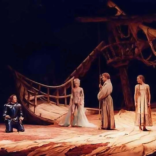 Two men, a woman and a spirit in the wreckage of a large wooden ship.
