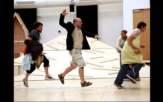 The cast skipping in rehearsal.