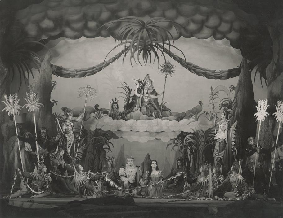 Ferdinand and Miranda watch the spirits perform the Masque in front of a painted tropical forest