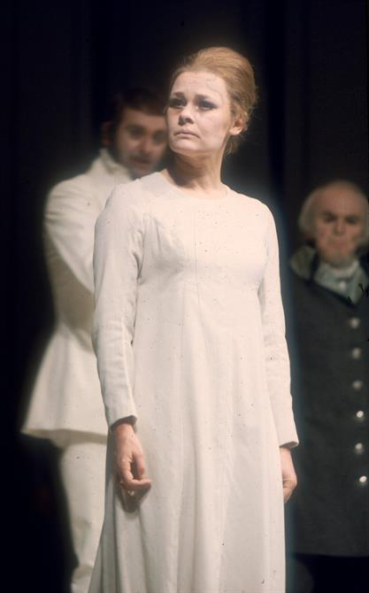 Judi Dench as Hermione in The Winter's Tale, wearing a white robe and looking worried