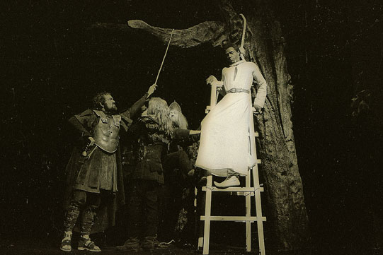 Production image Lucius (Ian Hogg, far left) prepares to hang Aaron (Calvin Lockhart).