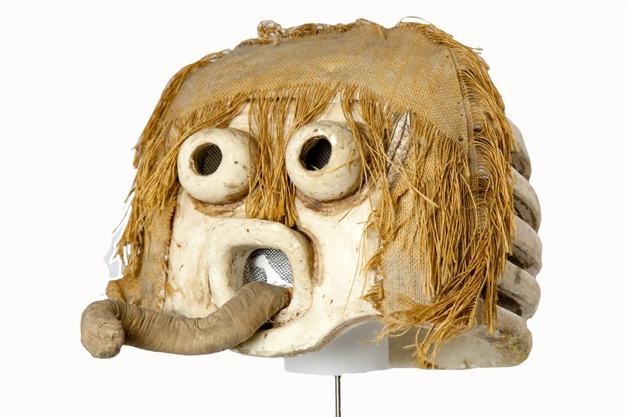 Grotesque greek mask with bulging eye sockets, hair made from sacking and a long snaking protruding tongue