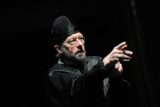 Stephen Boxer as Archbishop Aguiar Y Seijas, dressed all in black