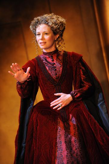 Catherine Hamilton as the Vicereine, wearing an elaborate red gown