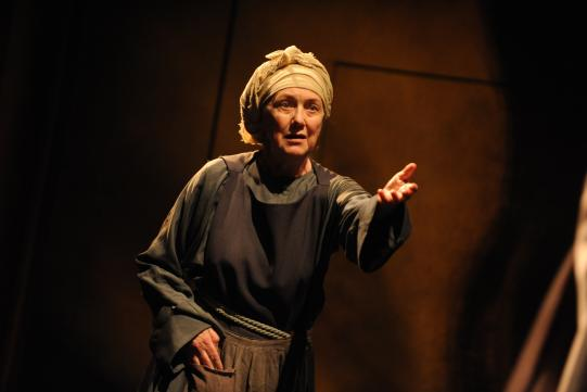 Marty Cruikshank as Brigida, wearing a peasant's outfit