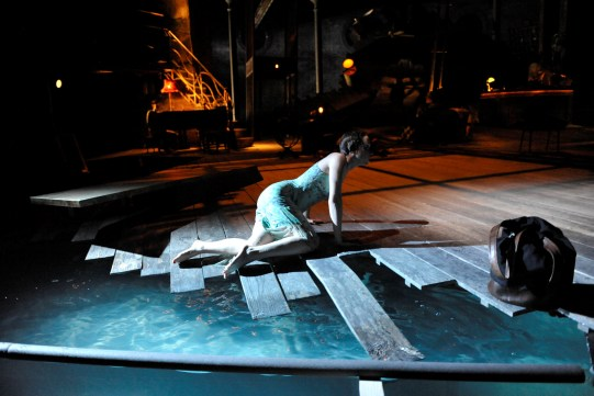 Emily Taaffe as Viola in Twelfth Night climbing out of a swimming pool