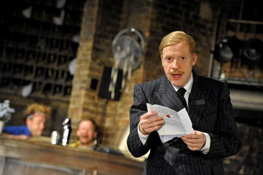 Jonathan Slinger as Malvolio in Twelfth Night, reading a letter