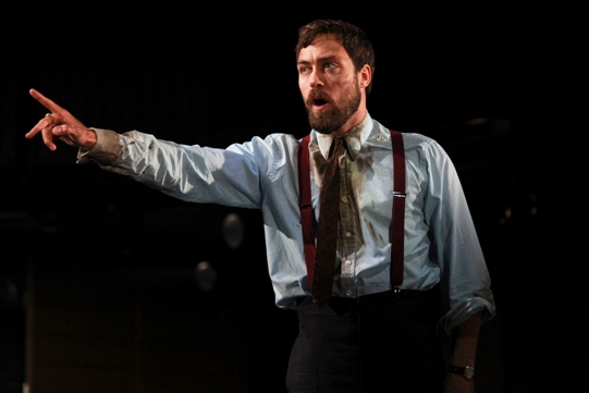 Alex Hassell as Demetrius, in a dirty shirt and tie.