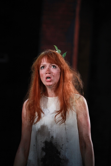 Lucy Briggs-Owen as Helena, with mud on her face and white dress and leaves in her hair.