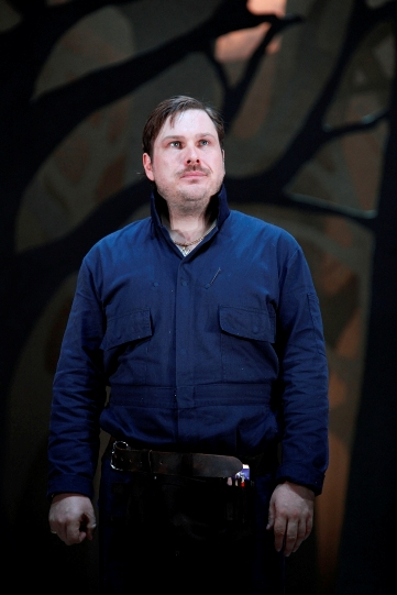 Marc Wootton  as Bottom, in blue shirt and black trousers.