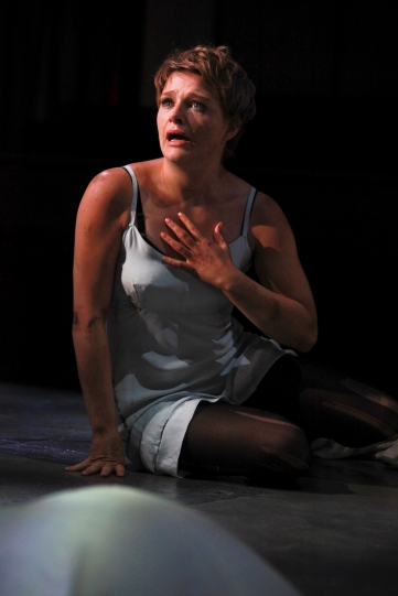 Matti Houghton as Hermia. sat on the stage in a light grey slip.