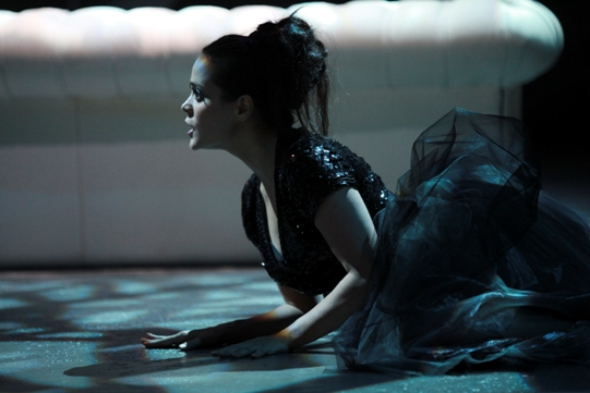Maya Barcot as Fairy in a glittery black top and black skirt.