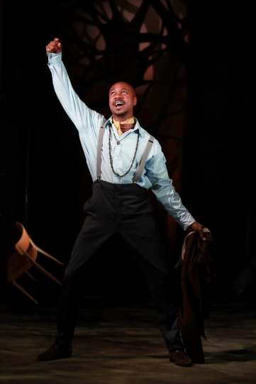 Nathaniel Martello-White as Lysander, throwing his arm in the air.