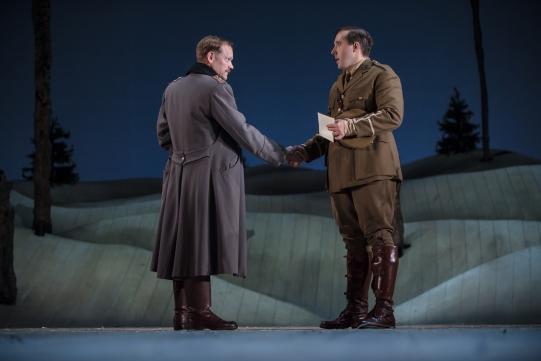 Nick Haverson as Leutnant Kohler and Joseph Kloska as Bruce Bairnsfather, shaking hands in The Christmas Truce.